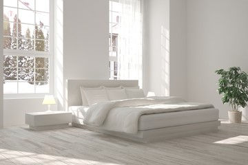 White bedroom with winter landscape in window. Scandinavian interior design