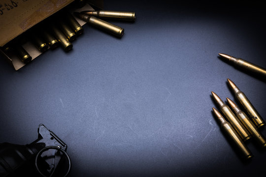 Rifle cartridges 5.56 mm and magazine on a black background