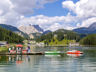 lake with paddleboat, Italy, South Tyrol, lake Misurina