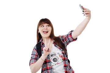 Happy smiling woman taking selfie photo on smartphone