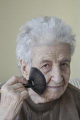 Senior woman doing makeup
