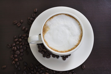 Hot coffee in a white cup on the table.