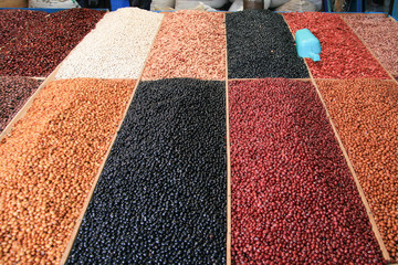 Beans of different colors in a market.