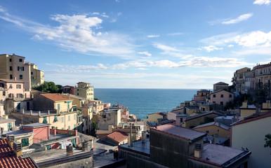 Amazing landscape view of Corniglias sea, horizon, sky and buildings.