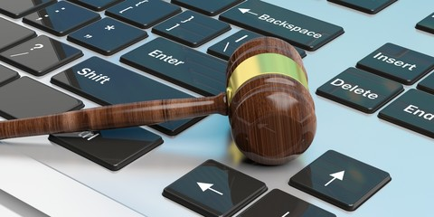 Judge or auction gavel on a keyboard. 3d illustration