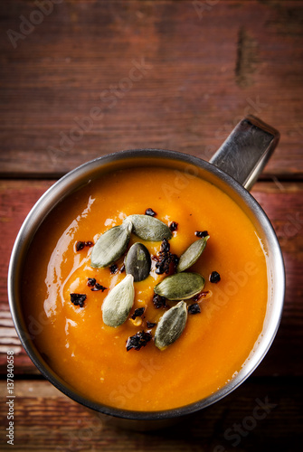 Photo: Roasted pumpkin soup in metal mug with seeds and smoked paprika ...