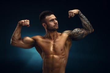 Men's physique. Champion. Bodybuilder.