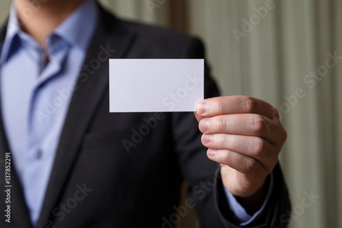 Businessman Holding Visit Card Man Showing Blank Business Person In Black Suit