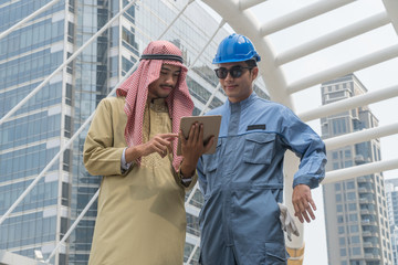 Arabian businessman holding tablet for a young engineer View project.