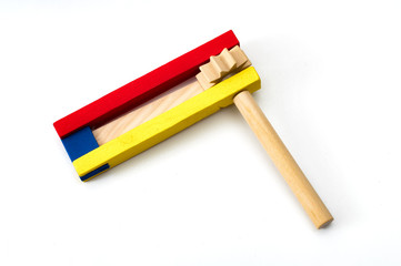 Judaism and religious holyday with wooden noisemaker or gragger (a traditional toy) for purim celebration holiday (jewish holiday)