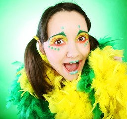 funny girl over green background