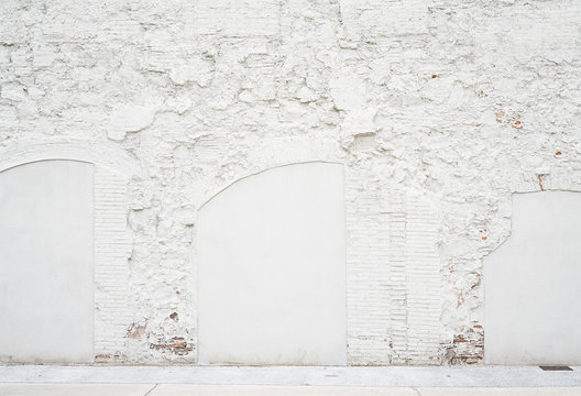 Abstract vintage empty background.Photo of grungy white painted brick wall texture. White washed brickwall surface.Horizontal mockup. Front side view.