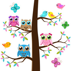 Four owls on a tree with butterflies and birds