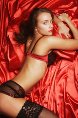 sexy woman on red fabric