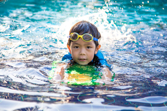 boy learn to swim in the swimming pool