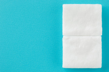square cottons on blue background