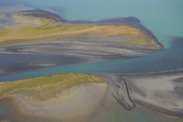 Aerial view over Lake Laitaure showing silt deposits from the Rapa river forming sand spits and vegetational growth, Sarek National Park, Laponia World Heritage Site, Lapland, Sweden, September 2008