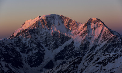 First red light on Nakratau (4,269m) (right) and Donguzorun (4,468m) seen from Elbrus, Caucasus, Russia, June 2008
