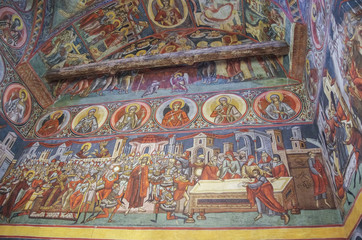 Frescoes inside church in monastery Voronet. One of Romania's painted Orthodox monasteries in southern Bucovina,region Suceava, Romania