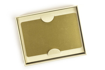 Blank VIP golden card in gift box, on white
