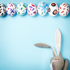 Easter bunny on a blue background. Rabbit. Easter ideas. Easter eggs. Space for text. Happy easter.