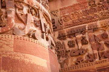Ornate Stone Wall At The Qutub Minar In Delhi