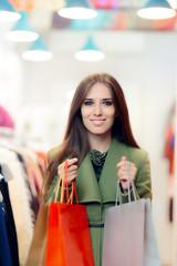 Elegant Shopping Woman Wearing a Green Coat in Fashion Store