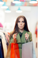 Surprised Shopping Woman Wearing a Green Coat in Fashion Store