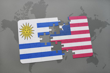 puzzle with the national flag of uruguay and liberia on a world map