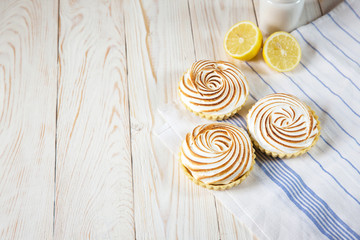 Tartlets with white cream and lemon curd shallow depth of field
