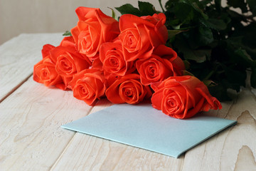 Bouquet of red roses on a wooden background
