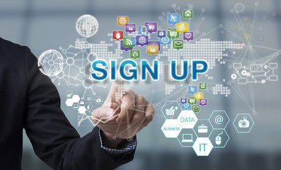 Businessman hand chooses Sign up wording on interface screen. internet technology service concept. can used for cover page presentation and web banner.