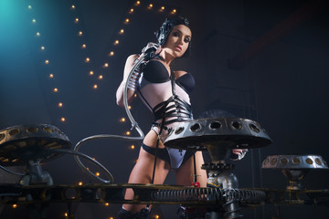 Girl - DJ near an unusual player in helmet