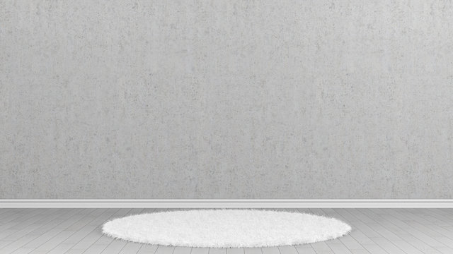 White carpet in front of concrete wall