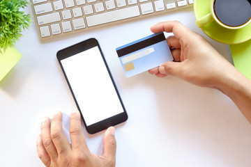 Online payment,Man's hands holding a credit card and using smart phone for online shopping