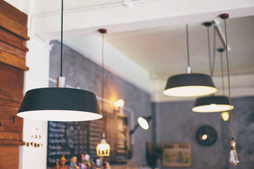 Modern lanterns in cafe interior.