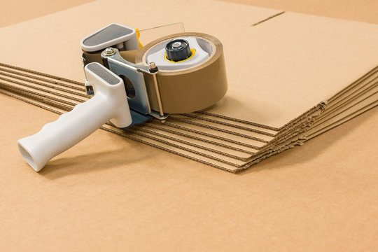 Industrial single wall corrugated cardboard Boxes and tape gun or dispenser