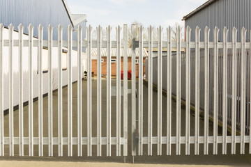 Set of locked spiked security gates at an industrial or commercial premises