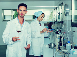 Man in chemical laboratory on winery