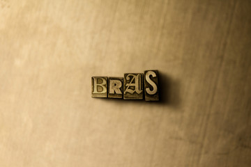 BRAS - close-up of grungy vintage typeset word on metal backdrop. Royalty free stock illustration.  Can be used for online banner ads and direct mail.