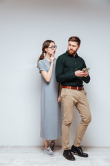 Vertical image Female nerd with bearded man which recounts money