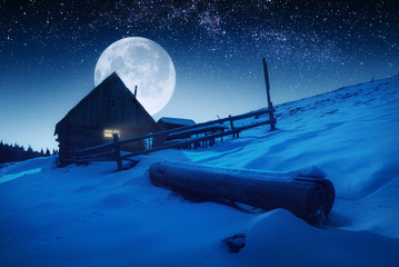 Moon rising above the carpathian village