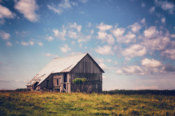 An Old Abandoned Barn in a Field