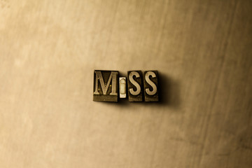 MISS - close-up of grungy vintage typeset word on metal backdrop. Royalty free stock illustration.  Can be used for online banner ads and direct mail.