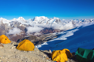 High Altitude Camp of Mountain Expedition Summits on Horizon