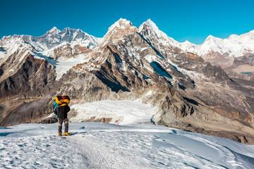 Mountain Climber ascending high Altitude Peak walking on Snow terrain
