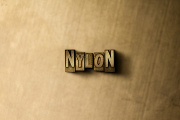 NYLON - close-up of grungy vintage typeset word on metal backdrop. Royalty free stock illustration.  Can be used for online banner ads and direct mail.
