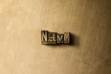 NAVY - close-up of grungy vintage typeset word on metal backdrop. Royalty free stock illustration.  Can be used for online banner ads and direct mail.