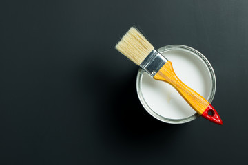 White paint and brush