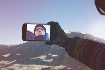 mountain girl snaps a selfie